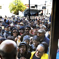 In this photo taken April 9, 2012, folks are seen pushing and shoving trying to gain entry into the Howard Theatre during the official opening in Washington, D.C. The community day event marked the grand opening of the historic Howard Theatre where several hundred folks attended and several community leaders spoke.