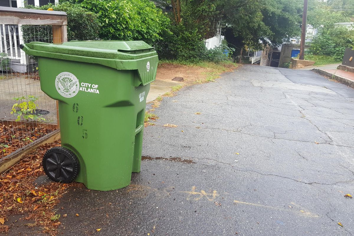 a picture of a trash can on the street