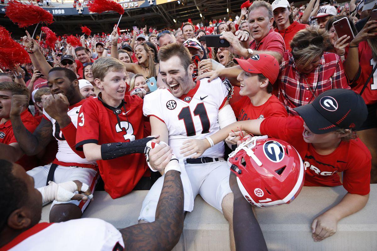 Georgia Bulldog Jake Fromm celebrates with fans