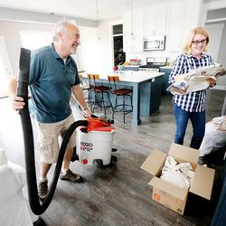 Steve and Michelle Allen work to unpack their belongings Wednesday, May 20, 2015, as they move into their new home in Heber.