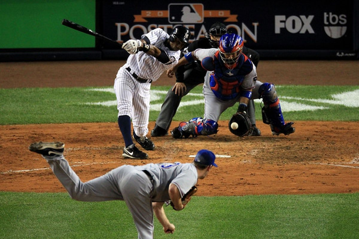 Curtis Granderson of the New York Yankees strikes out against Cliff Lee #of the Texas Rangers in Game Three of the ALCS during the 2010 MLB Playoffs at Yankee Stadium on October 18 2010 in New York New York.  (Photo by Travis Lindquist/Getty Images)
