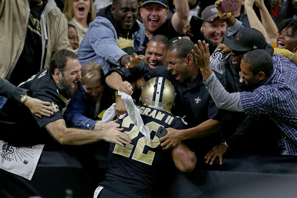 NEW ORLEANS, LA:  New Orleans Saints running back Mark Ingram (22) celebrates with fans after scoring a touchdown against the Atlanta Falcons defense at the Mercedes-Benz Superdome.