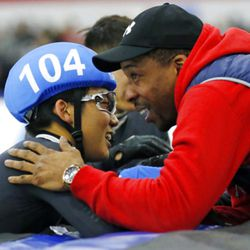 Thomas Insuk Hong (104) is congratulated by head coach Anthony Barthell after earning a nomination to the U.S.Olympic team after competing in the men's 1000-meter race during the U.S.Olympic short track speedskating trials Sunday, Dec. 17, 2017, in Kearns, Utah. (AP Photo/Rick Bowmer)