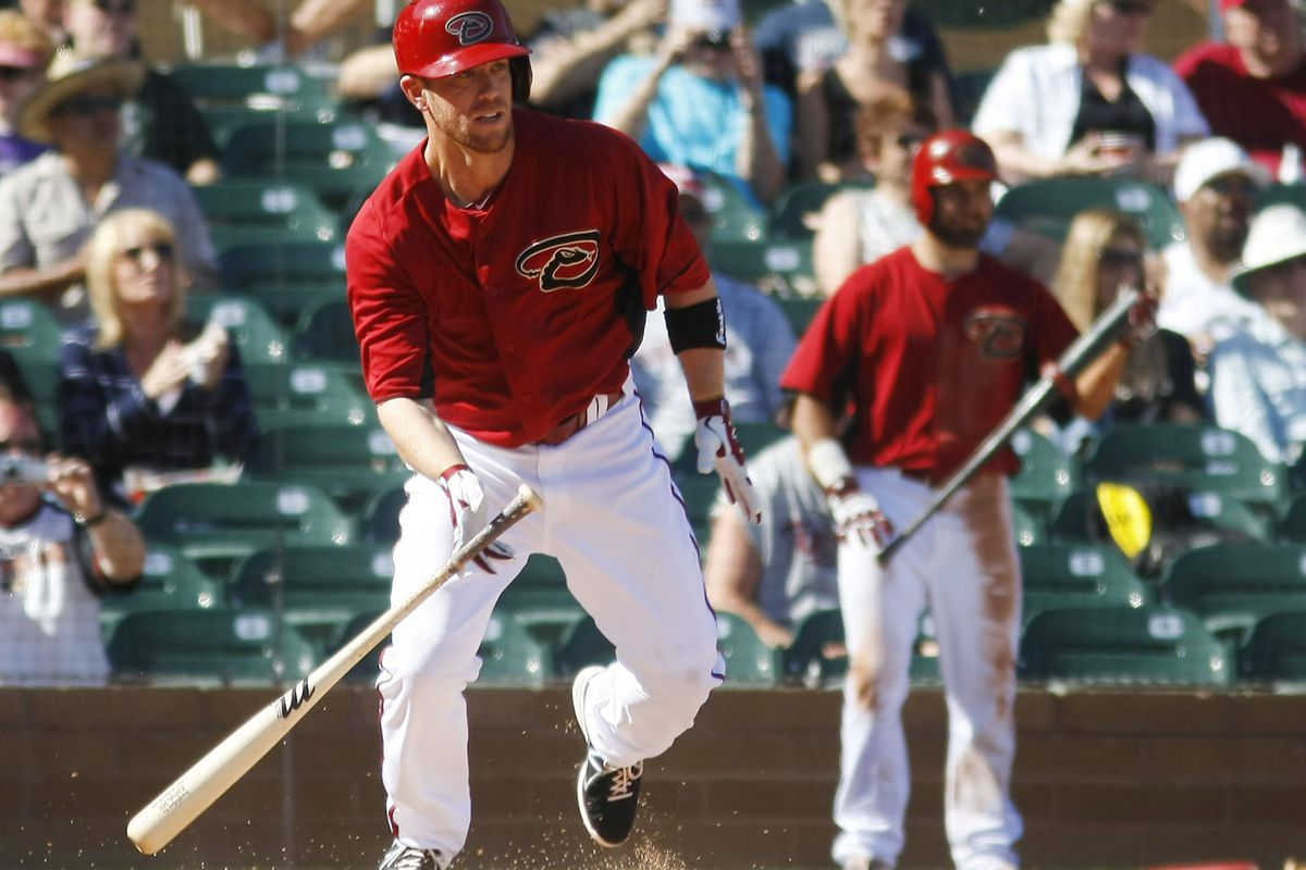 Pinch-hitter Aaron Hill delivers an RBI hit yesterday against the Reds.