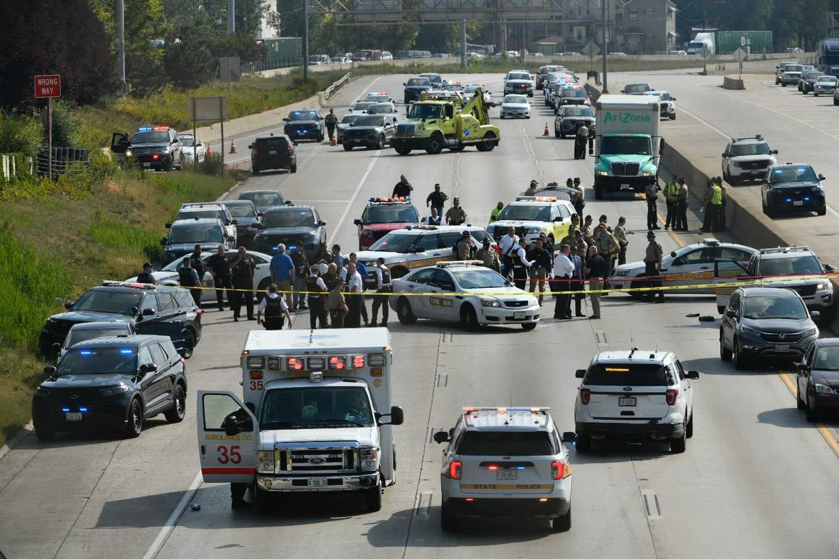 Police investigate on the Dan Ryan Expressway at 43rd Street where a state trooper was shot Friday, Oct. 1.