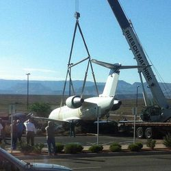 A SkyWest plane is moved Tuesday, July 17, 2012, after a pilot suspected of killing a former girlfriend in Colorado jumped a fence at the St. George Municipal Airport and stole the plane. After driving it into a parking lot, Brian Hedglin, 40, killed himself, police say.
