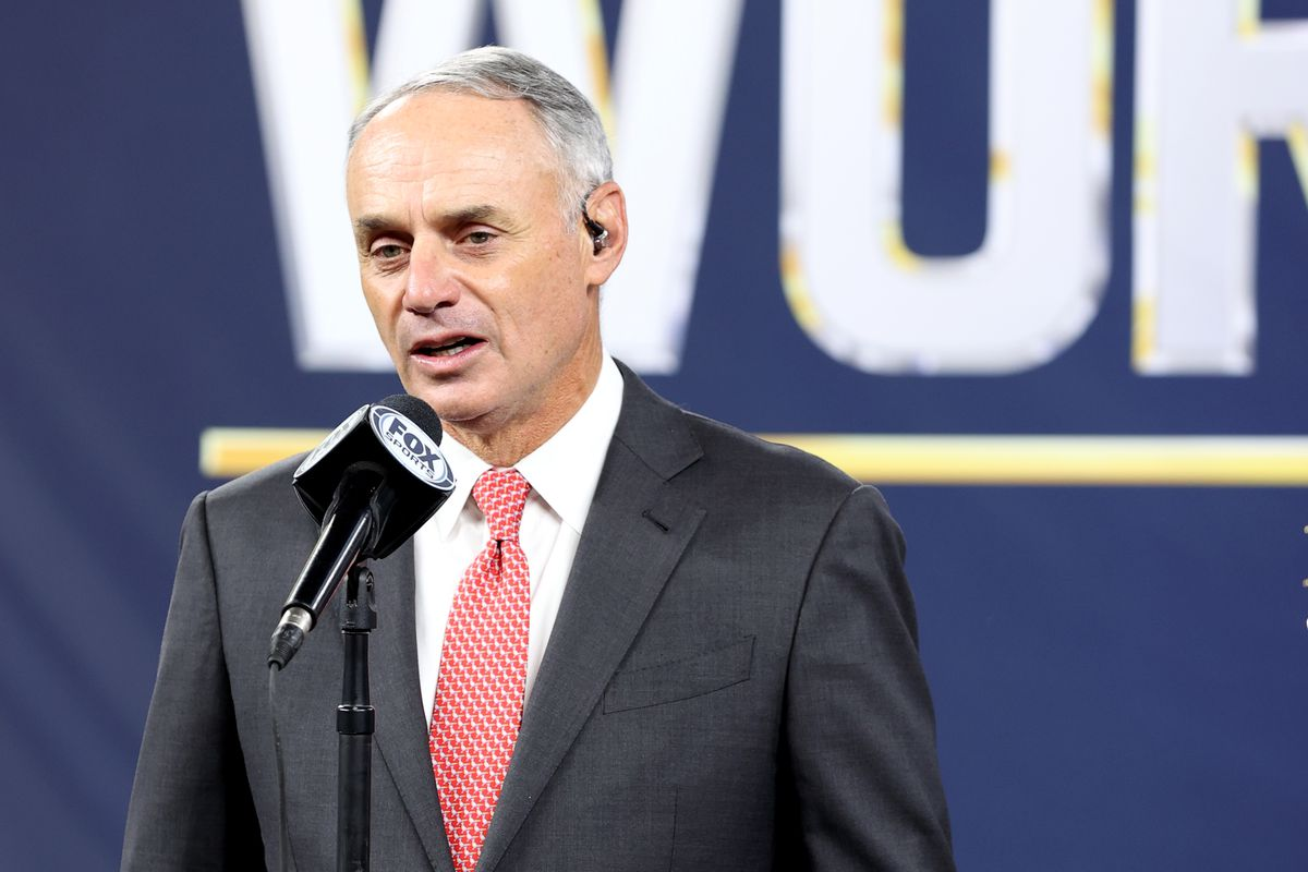 Major League Baseball Commissioner Robert D. Manfred Jr. presents the Commissioners Trophy to Los Angeles Dodgers Owner Mark Walter after the Dodgers defeated the Tampa Bay Rays in Game 6 to clinch the 2020 World Series at Globe Life Field on Tuesday, October 27, 2020 in Arlington, Texas.