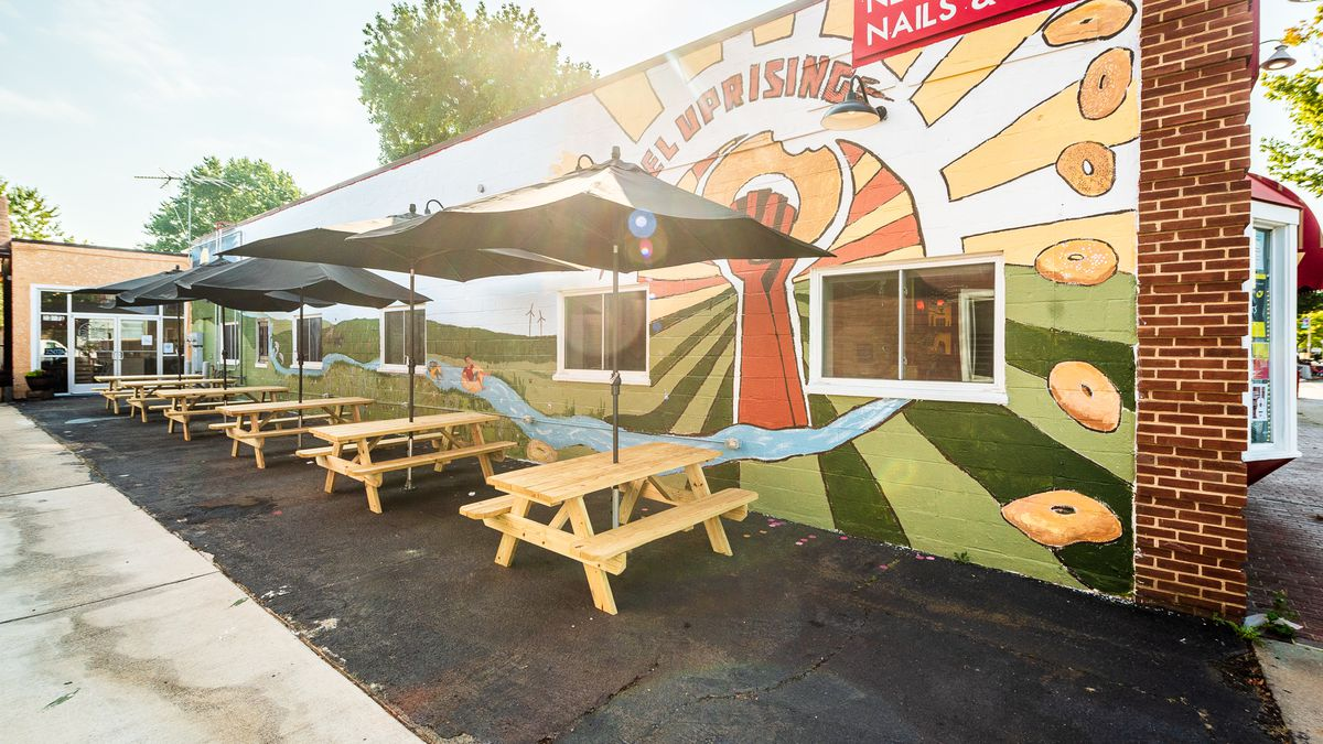 The patio at Bagel Uprising features a fresh mural
