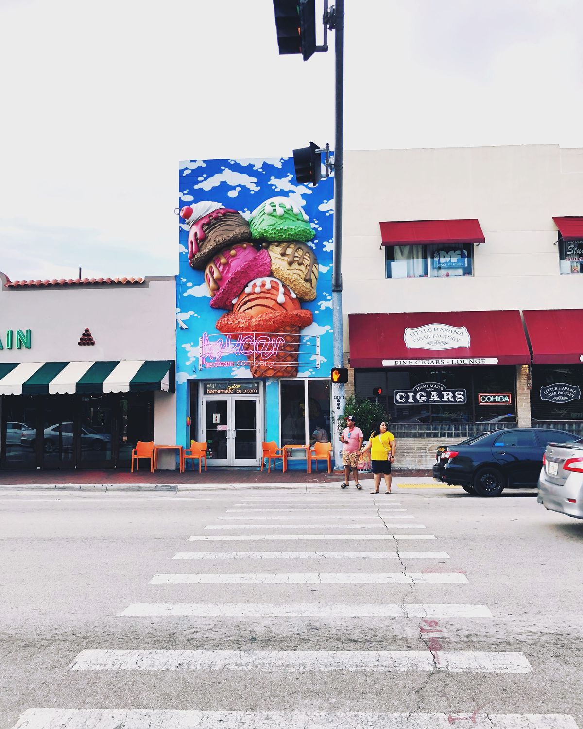 road with a bright ice cream decorated building