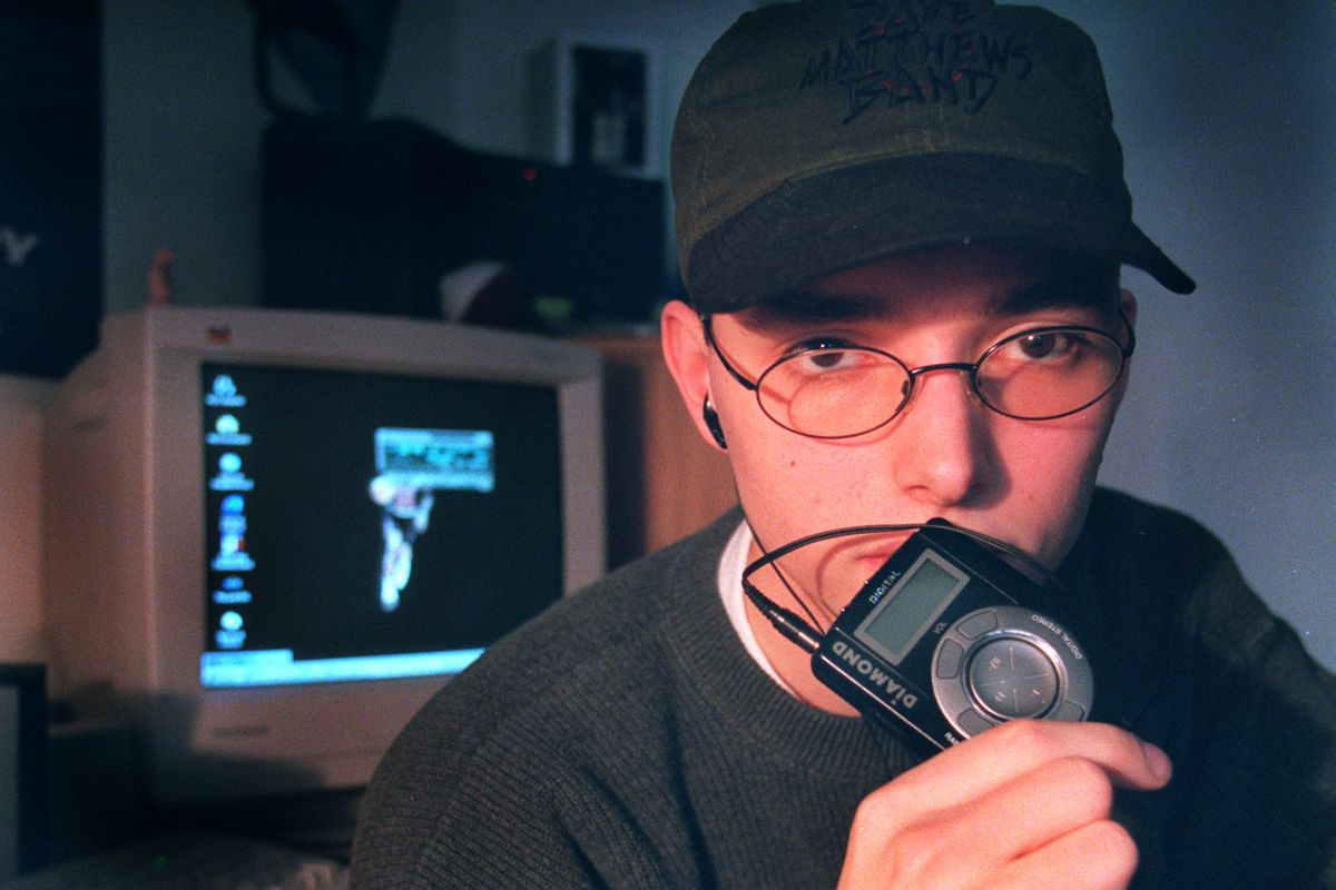 A college student with an early MP3 player in 1999.