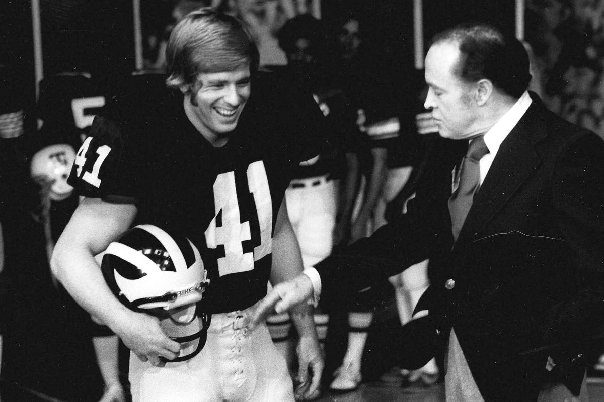 Michigan All-America RB Rob Lytle smiling with entertainer Bob Hope