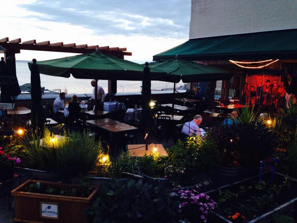 The outdoor patio at Maximilien, with views of Elliott Bay.