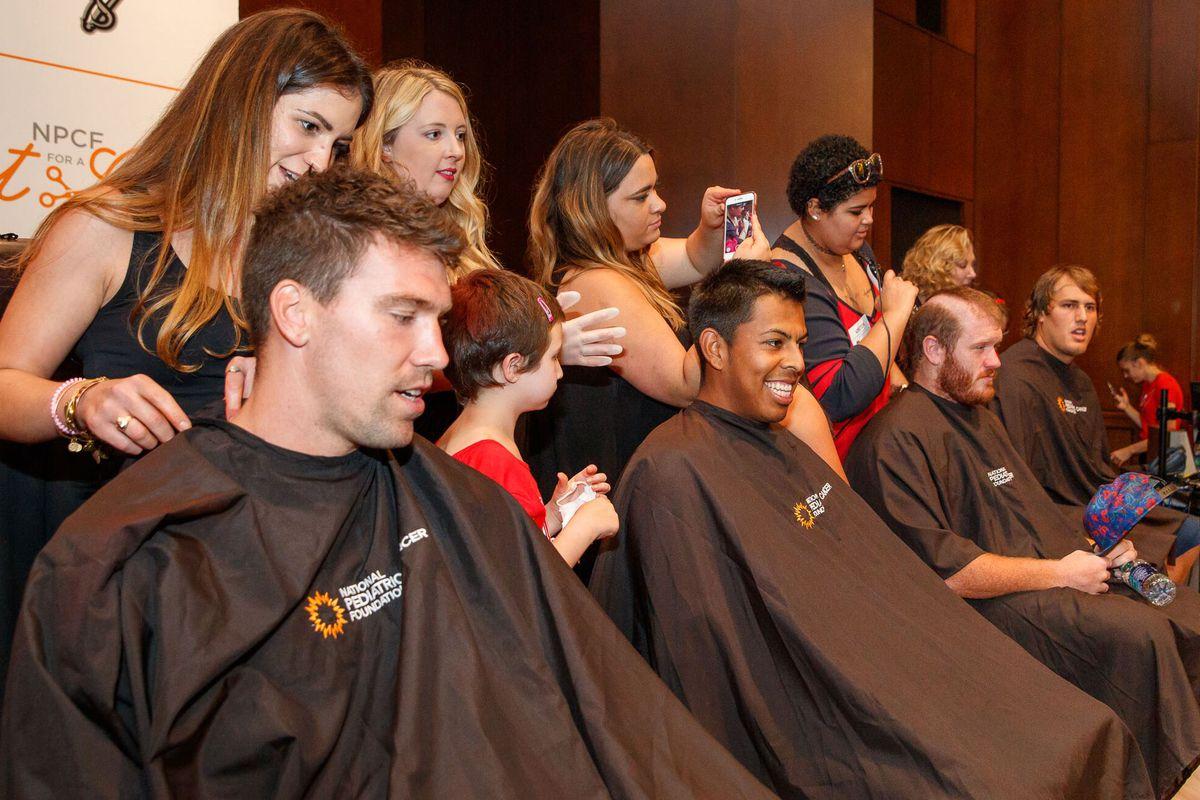 Bucs players participate in Cut For A Cure in 2017