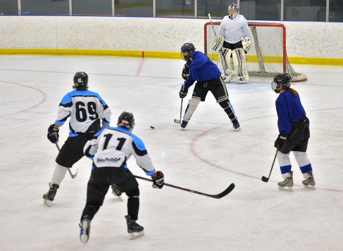 The Chicago North Stars (in blue jerseys) practice with a men's team at Johnny's IceHouse West.