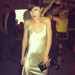 Karla Deras in her designed jewels and a sultry silk slipdress