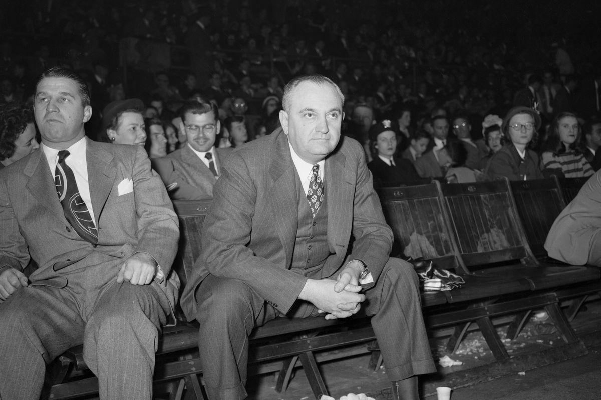 Adolph Rupp Watching Basketball Game