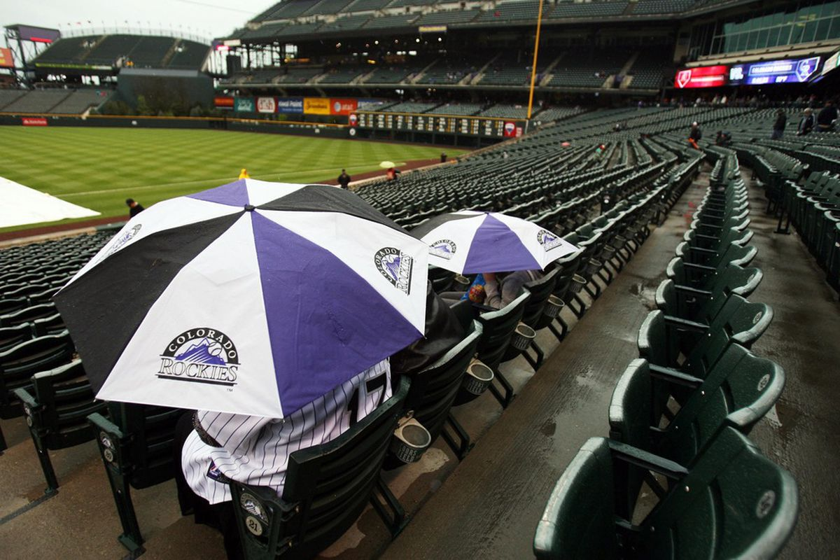 April 14, 2012; Denver, CO, USA; A general view as a few fans look out over the field during a rain delay before the game between the Arizona Diamondbacks and the Colorado Rockies at Coors Field.  Mandatory Credit: Chris Humphreys-US PRESSWIRE