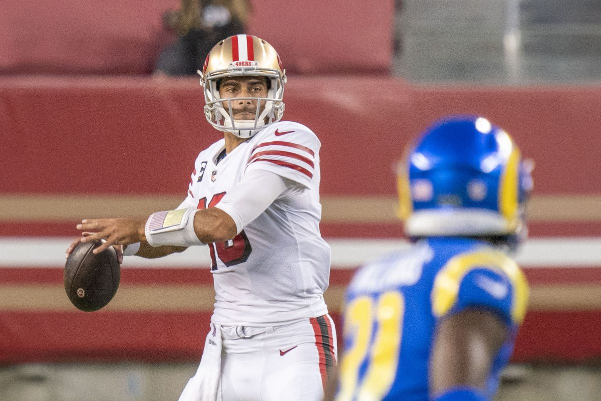 San Francisco 49ers quarterback Jimmy Garoppolo (10) passes the football against the Los Angeles Rams during the second quarter at Levi's Stadium.