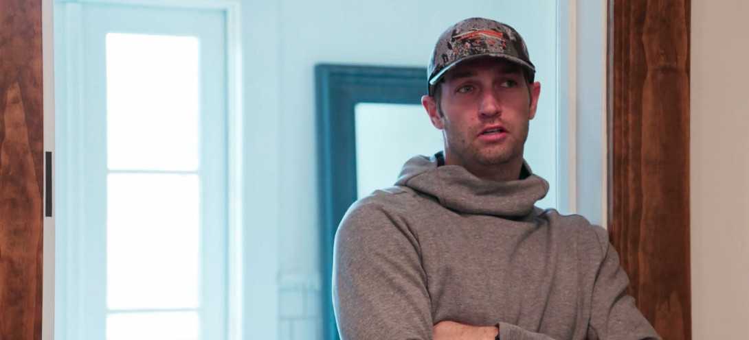Cutler wearing a camouflage hat