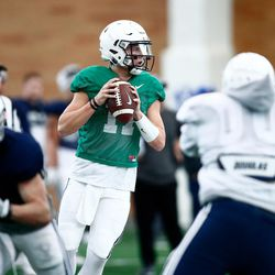 BYU quarterback Zach Wilson looks to pass during the Cougars' practice in the Indoor Practice Facility on Thursday, March 15, 2018 in Provo.
