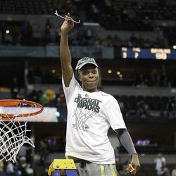 Baylor guard Odyssey Sims (0) holds the net after the NCAA Women's Final Four college basketball championship game against Notre Dame, in Denver, Tuesday, April 3, 2012.  Baylor won the championship 80-61. (AP Photo/Eric Gay)