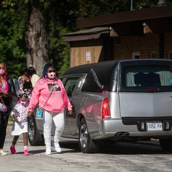 Mourners walk outside Abundant Living Christian Center in Dolton, Ill. during the wake and funeral of eight-year-old DaJore Wilson Friday morning, Sept. 18, 2020. Wilson was fatally shot in Canaryville Sept. 7.