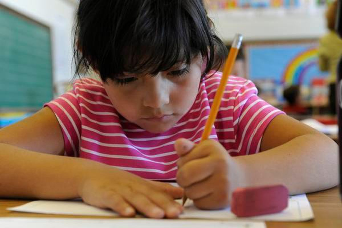 A Lincoln Elementary student practices her writing skills in this 2008 file photo.