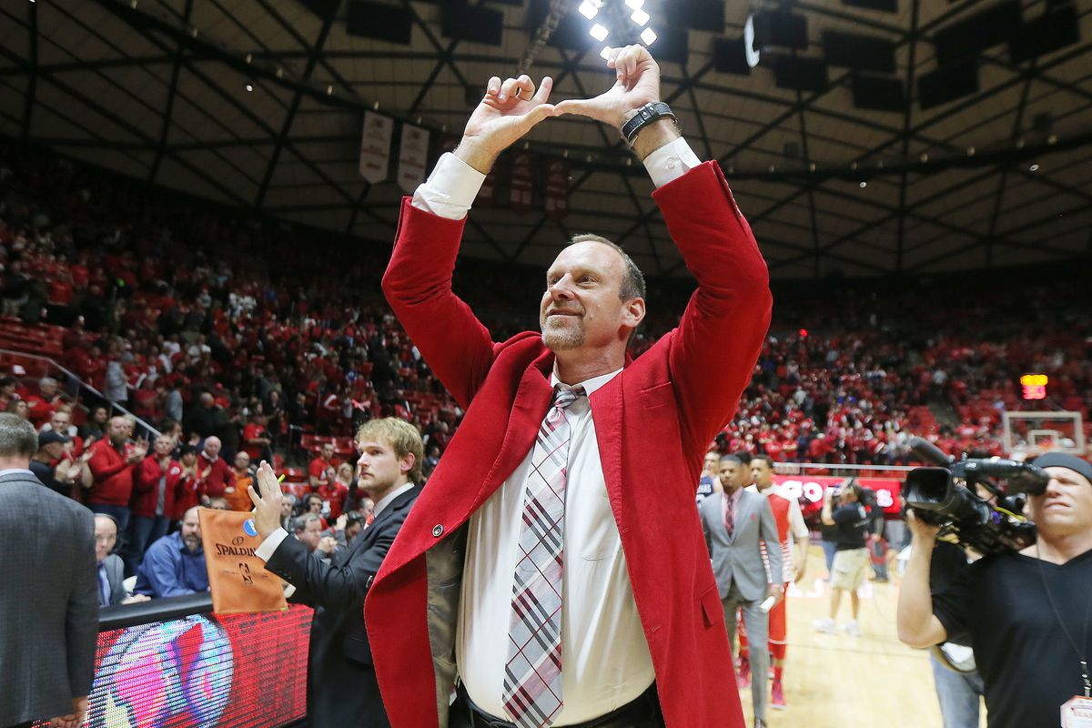 Utah head coach Larry Krystkowiak throws up his U sign to the crowd after the Utes defeated BYU at the Huntsman Center 83-75 in Salt Lake City Wednesday, Dec. 2, 2015.