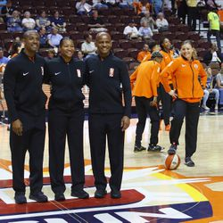 The Connecticut Sun's Rachel Banham photobombs the referees before the game.