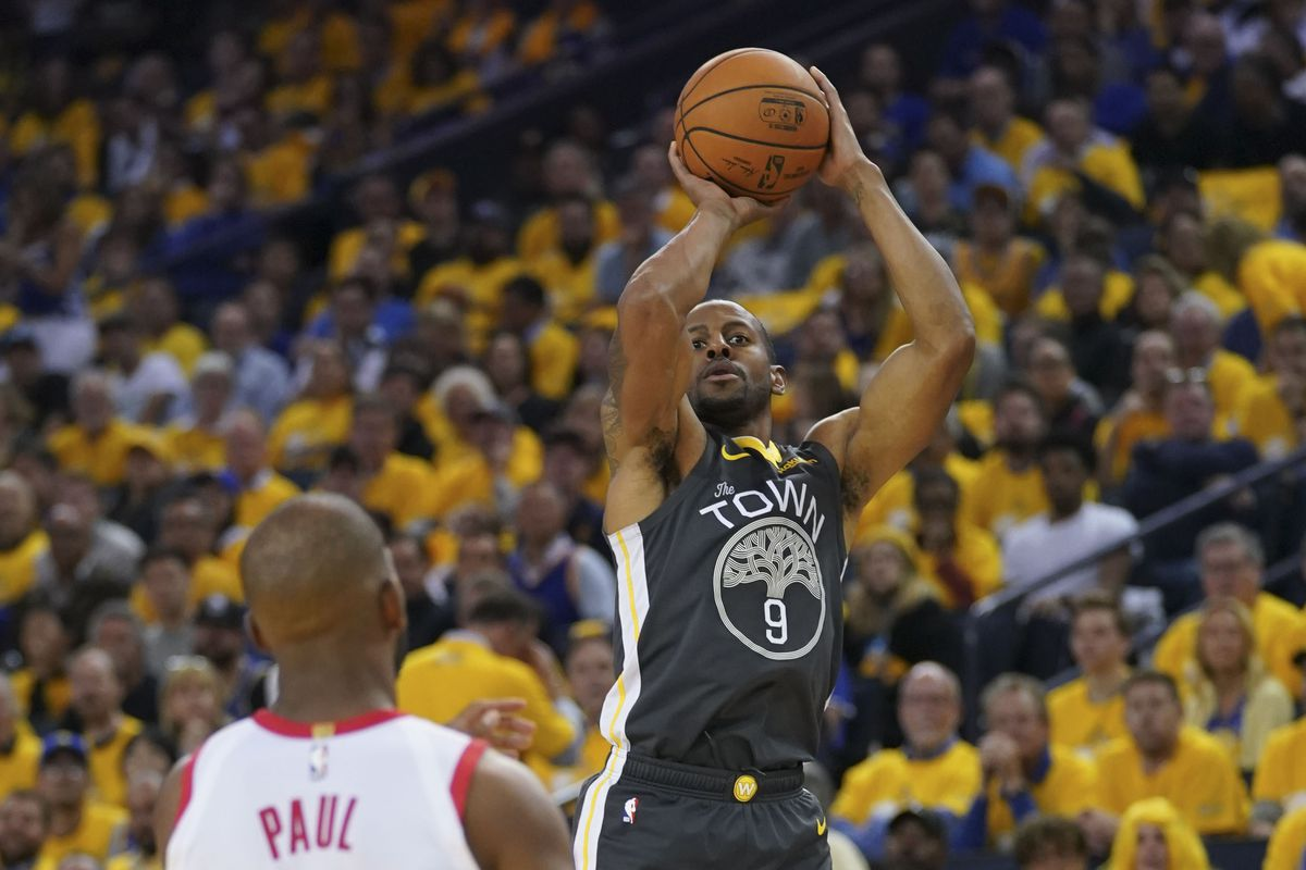 Golden State Warriors guard Andre Iguodala shoots the basketball against Houston Rockets guard Chris Paul during the third quarter in game two of the second round of the 2019 NBA Playoffs at Oracle Arena. The Warriors defeated the Rockets 115-109.