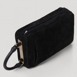 """<a href=""""http://www.rachelcomey.com/womens-store/accessories/matinee.html?color=Black"""">Matinee</a>, $595"""