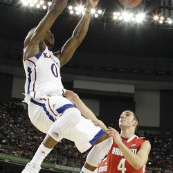 Kansas' Thomas Robinson, left, dunks over Ohio State's Aaron Craft, right, during the second half of an NCAA Final Four semifinal college basketball tournament game Saturday, March 31, 2012, in New Orleans.