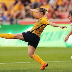 Utah Royals FC forward Amy Rodriguez (8) works to control the ball with Orlando City defender Ali Krieger (11) moving in as Utah Royals and the Orlando Pride play at Rio Tinto Stadium in Sandy on Wednesday, May 9, 2018.