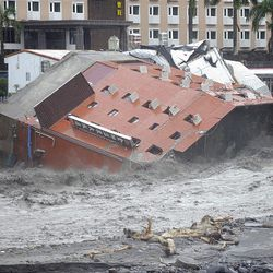 A collapsed hotel building is seen in heavily flooded river after Typhoon Morakot hit Taitung county, Sunday in Taitung County, eastern Taiwan.