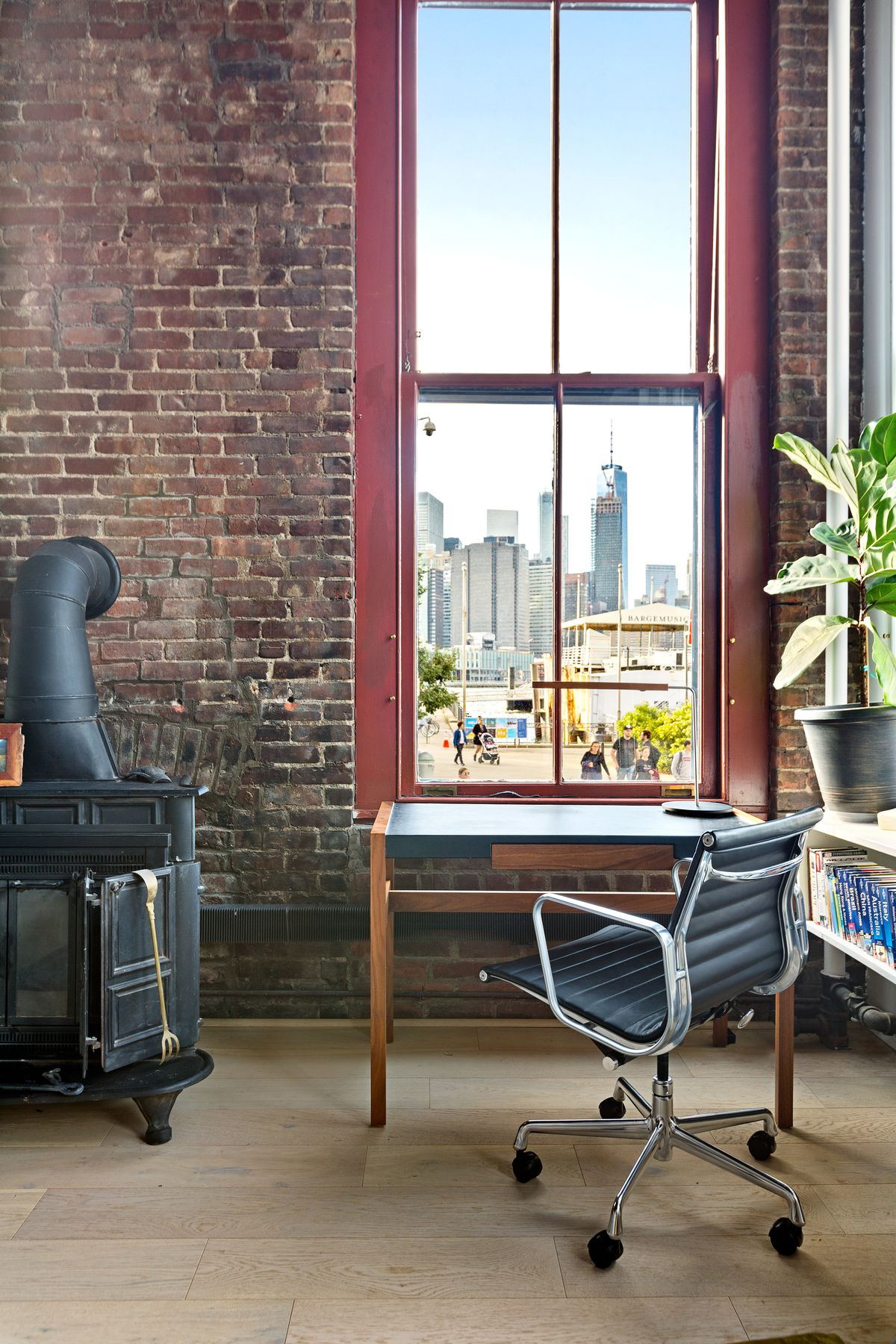 A large window with views of Lower Manhattan.