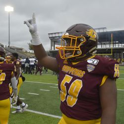 Tico Brown puts a finger in the air to signify that CMU is #1 in post-game festivities.