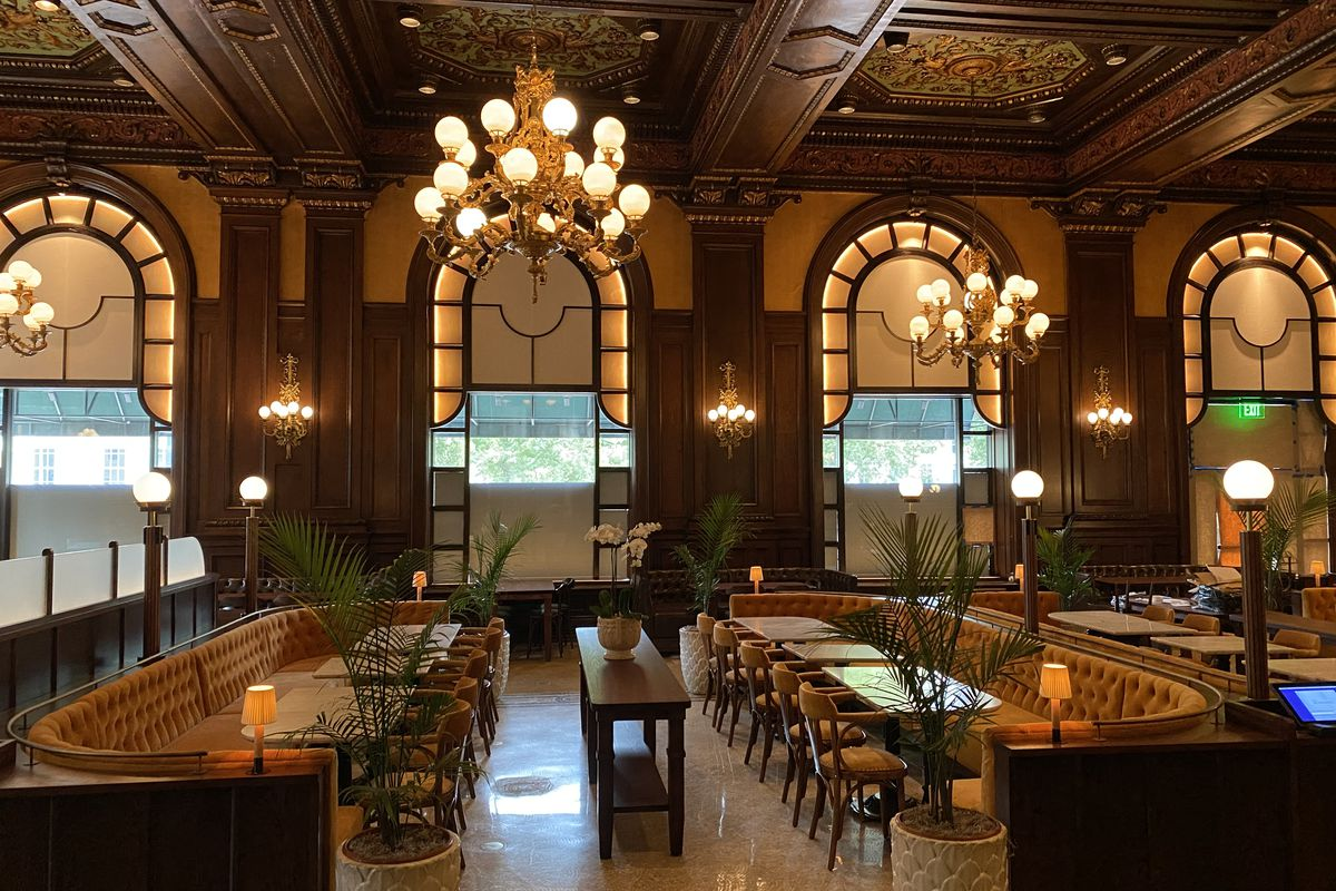 inside of upscale restaurant with globe lights and booths