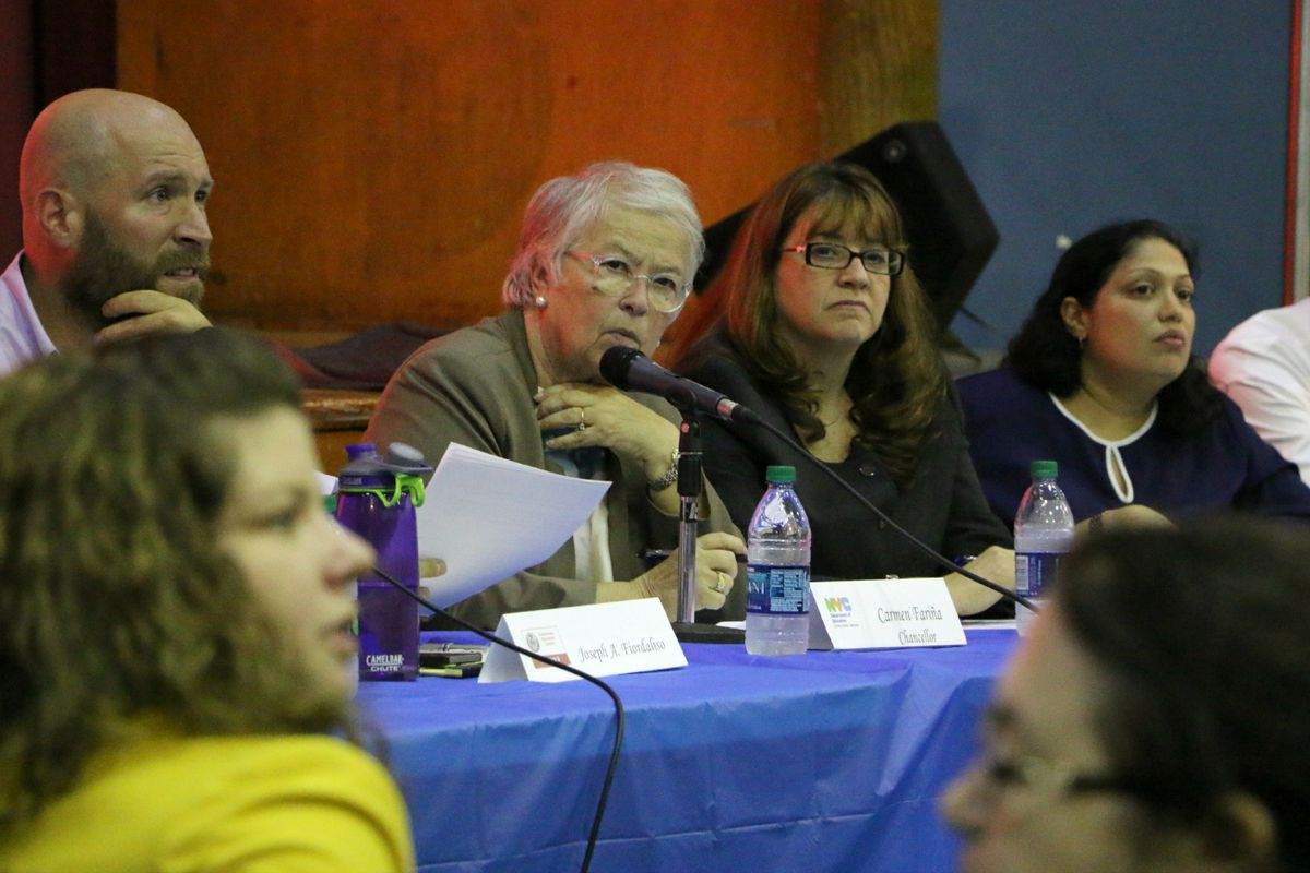 Chancellor Fariña spoke about school diversity at a town hall in District 3 in 2015. She is seated next to Superintendent Ilene Altschul, second from right.