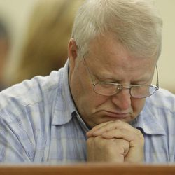Chuck Cox, the father of missing Utah woman Susan Powell, pauses during a break in a court hearing regarding the custody of his two grandsons, Wednesday, Sept. 28, 2011, in Tacoma, Wash. Cox's grandsons are currently with Cox and his wife, but their father, Josh Powell, is asking for custody to be returned to him.