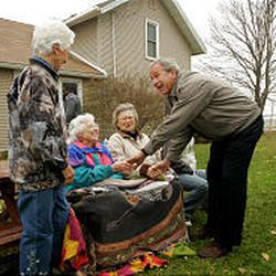 President Bush greets Evelyn Kepler, left, Helen Shireman and Mary Turgasen at their home at Sylvan-T. Farms Tuesday in Richland Center, Wis., a battleground state.