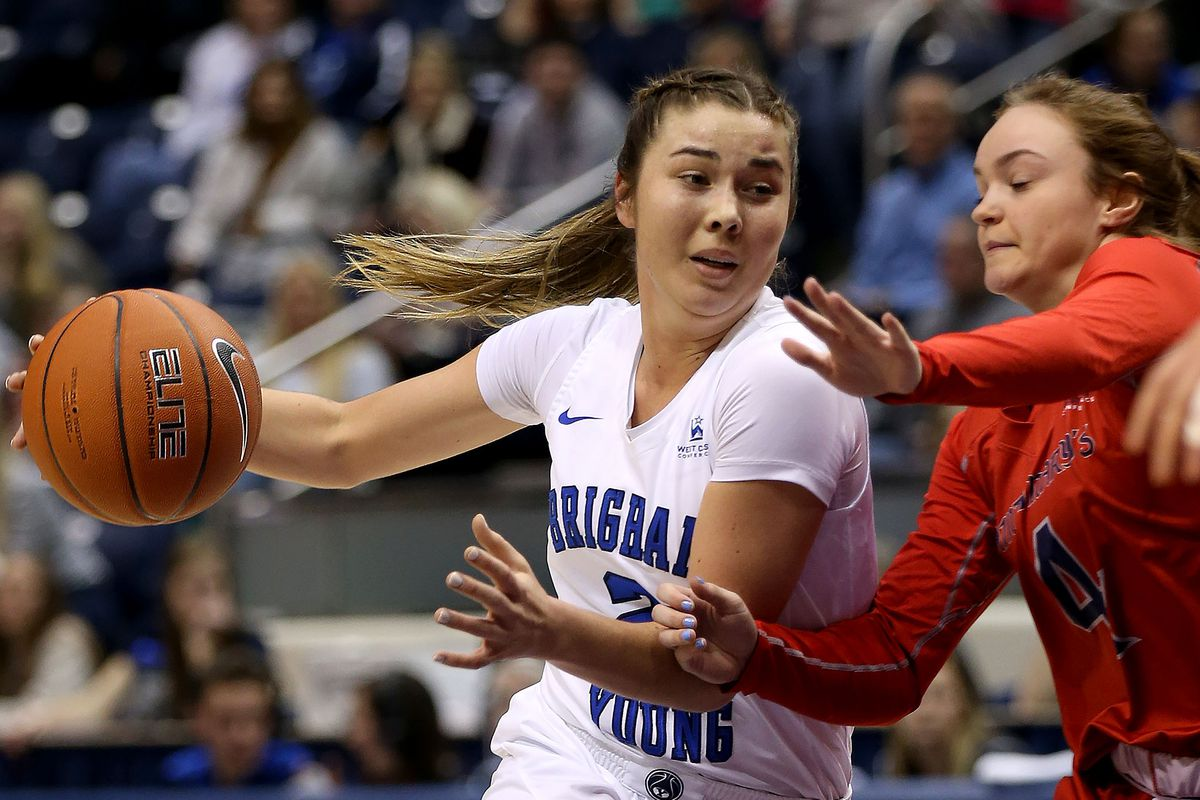 BYU Cougars guard Shaylee Gonzales (2) drives against Saint Mary's Gaels guard Taycee Wedin (4) at the Marriott Center in Provo on Thursday, Feb. 7, 2019.