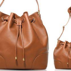 """<b>Tory Burch</b> Robinson Drawstring Bucket Bag in Luggage, <a href=""""http://www.toryburch.com/Robinson-Drawstring-Bucket-Bag/31139645,default,pd.html?dwvar_31139645_color=301&start=14&cgid=handbags-the-robinson-collection"""">$495</a>"""