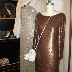Oscar de la Renta silver lame one shoulder sequin gown, $13,990<br />Haute Hippie gold drape back sequin dress, $795
