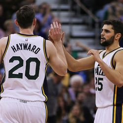 Utah Jazz forward Gordon Hayward (20) and guard Raul Neto (25) exchange high fives during NBA basketball against Chicago in Salt Lake City, Monday, Feb. 1, 2016.
