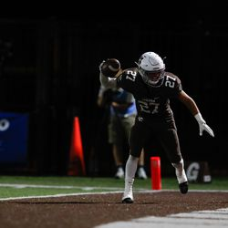 Mount Carmel's Tony Livermore (27) scores a touchdown during the game against Montini.