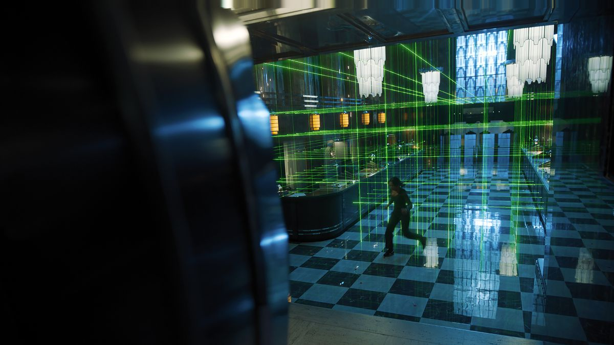 Zoey from Escape Room: Tournament of Champions jumps through a high-security laser grid