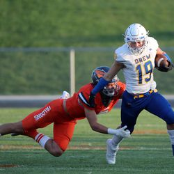 Skyridge's Collin Sheffield tries to tackle Orem's Mack Hixson during a high school football game at Skyridge High School in Lehi on Friday, Sept. 3, 2021.