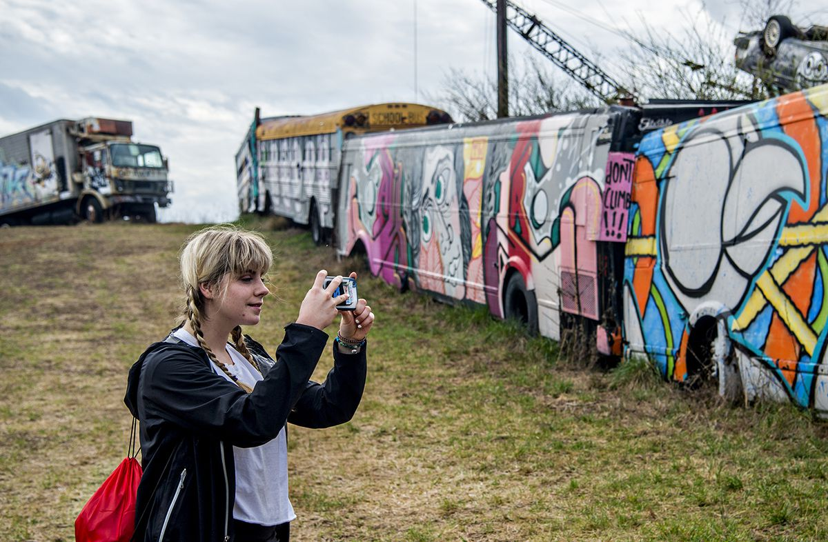 A bunch of graveyard photos with school buses and murals.