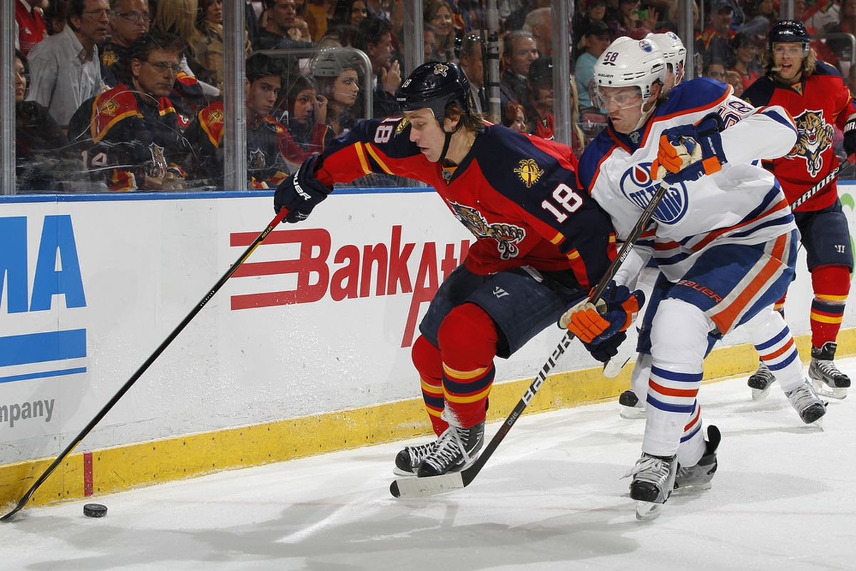 SUNRISE, FL - MARCH 23: Shawn Matthias #18 of the Florida Panthers and Jeff Petry #58 of the Edmonton Oilers battle for control of the puck on March 23, 2012 at the BankAtlantic Center in Sunrise, Florida. (Photo by Joel Auerbach/Getty Images)