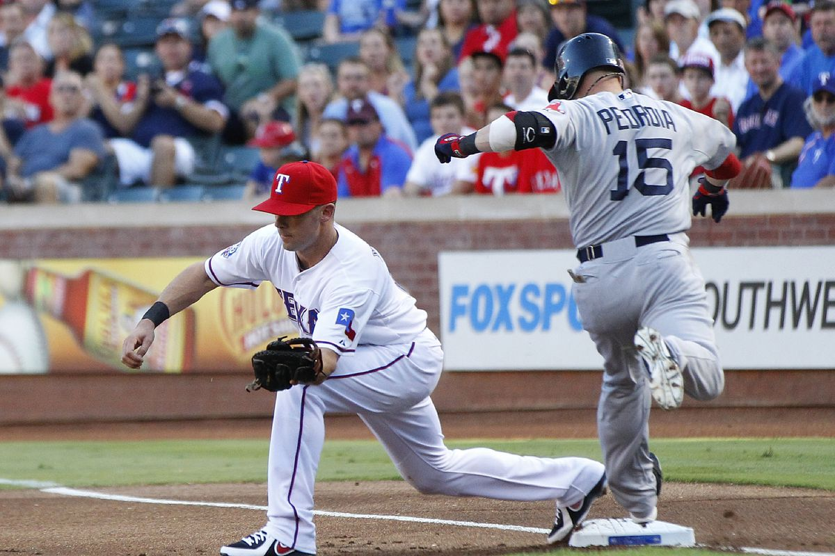 ARLINGTON, TX - JULY 25: Michael Young #10 of the Texas Rangers makes the out on  Dustin Pedroia #15 of the Boston Red Sox at Rangers Ballpark in Arlington on July 25, 2012 in Arlington, Texas. (Photo by Rick Yeatts/Getty Images)